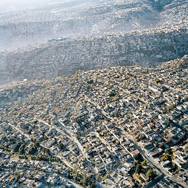 Amazing aerial perspective of Mexico City looks like a sea with wave-like formation