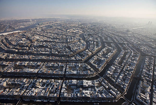 Circular, bird's eye view photograph of Amsterdam in Holland