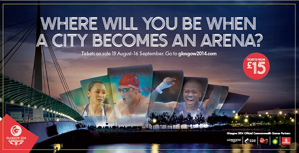 Billboard for the Commonwealth Games in Glasgow 2014 featuring Jessica Ennis and Nicola Adams as faces on the arena's facade.
