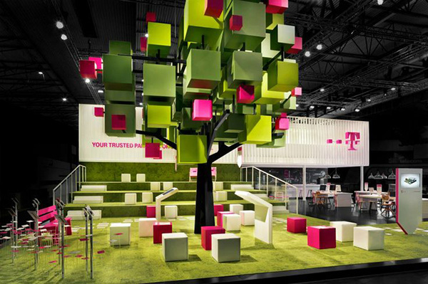 T Mobile's exhibition stand features a pixelated tree and its pixelated leaves as seats