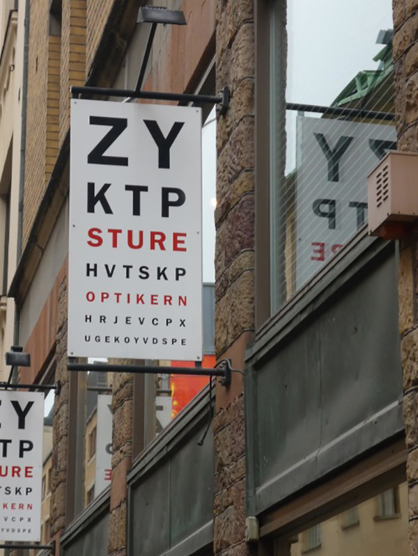 Clever eye exam business sign