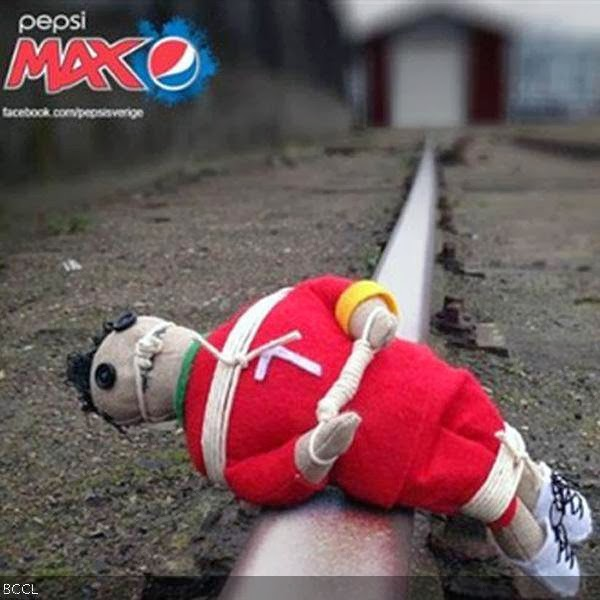Still image taken from controversial Pepsi advert shows a voodoo doll made to look like Cristiano Ronaldo laying on train tracks