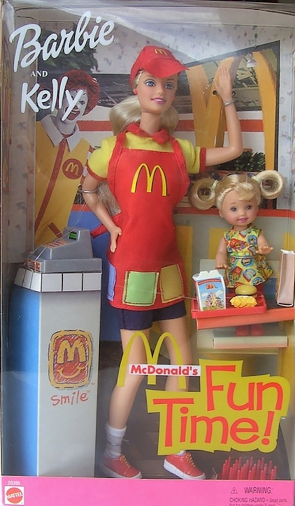 Image of Minimum Wage Barbie in her original box wearing a McDonald's uniform and apron surrounded by McDonalds props