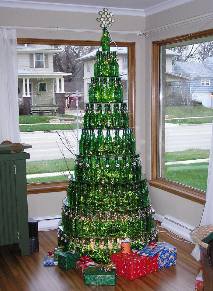 a christmas tree made out of empty beer bottles