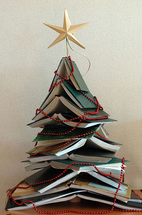 a beautiful christmas tree made out of books